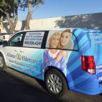Vehicle Wrap - 21 - partial white sienna minivan